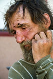 Homeless man in depression. Poor homeless beggar in depression royalty free stock photos