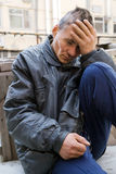 Homeless man in despair Stock Image