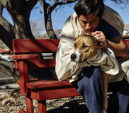 Homeless Man with Dog on Bench Royalty Free Stock Photos