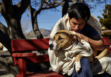 Homeless Man with Dog on Bench Royalty Free Stock Photo