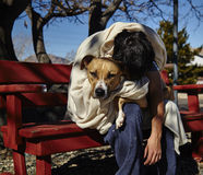 Homeless Man with Dog on Bench Royalty Free Stock Photography