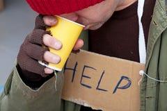 Homeless man drinkig hot tea Royalty Free Stock Photo