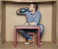 Homeless man drinking alcohol from a bottle Stock Images