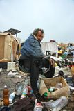 A homeless man in a dump Stock Image
