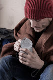 Homeless man eating preserve Royalty Free Stock Photo