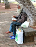 Homeless man eating. Royalty Free Stock Photo