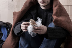 Homeless man eating sandwich Royalty Free Stock Photos