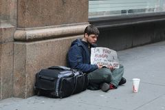Homeless man in front of Macy`s store in Midtown Manhattan Royalty Free Stock Photos
