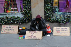 Homeless man in front of Sacks Fifth Avenue store in Midtown Manhattan Royalty Free Stock Photos