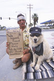 A homeless man and his dog Royalty Free Stock Photo