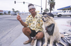 A homeless man and his dog Royalty Free Stock Image