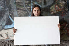 Homeless man holding a blank sign Royalty Free Stock Photography
