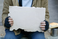 Homeless man holding a cardboard sign Royalty Free Stock Images