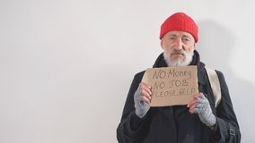 Homeless man holding sign, request for help, seeking help posing at studio