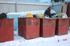 A homeless man, hungry man and the poor man looking for food in garbage cans collect waste unemployed stock photography