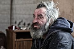 Homeless. Man lying in old abandoned house Royalty Free Stock Images