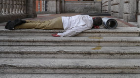 Homeless man. Lying on the stone flor In Rome, Italy Royalty Free Stock Images