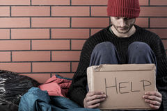 A homeless man need money. And asks for help stock photography