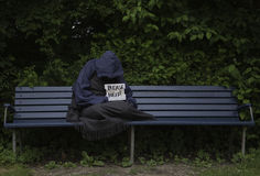 Homeless man on park bench Royalty Free Stock Images