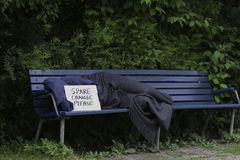 Homeless man on park bench Stock Photography