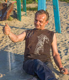 Homeless Man. Poor people in the children`s Playground at sunse Royalty Free Stock Images
