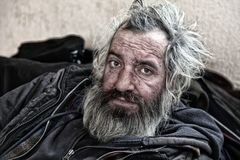 Old homeless man sitting in abandoned house. Homeless man sitting in old abandoned house Royalty Free Stock Photography
