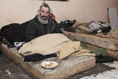 Old homeless man sitting in abandoned house stock images