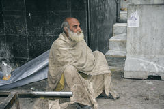 Homeless man. A homeless man sitting by the stairs of Data Darbar - Lahore, Pakistan Royalty Free Stock Images
