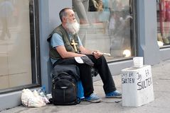 Homeless man sitting on a street with sign Royalty Free Stock Photo
