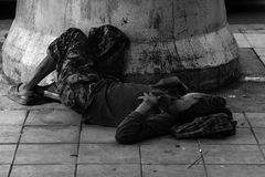 Homeless man sleep on footpath Royalty Free Stock Photos