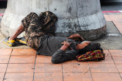 Homeless man sleep on pavement Royalty Free Stock Images