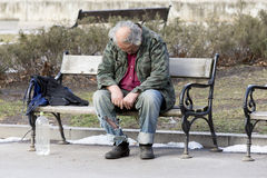 Homeless man sleeping on a bench Royalty Free Stock Photo