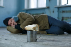 Homeless man sleeping on the cardboard Royalty Free Stock Photos