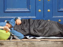 Homeless man sleeping. One of the many growing numbers of rough sleepers in doorways in the city of Liverpool. This man was sleeping in a doorway in Mount stock photo
