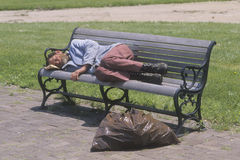 Homeless man sleeping on a park bench, Los Angeles, California Royalty Free Stock Images