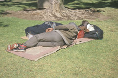 Homeless man sleeping in park, Los Angeles, California Royalty Free Stock Images