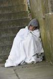 Homeless Man Sleeping Rough. On steps Royalty Free Stock Image