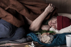 Homeless man sleeping on the street Royalty Free Stock Image