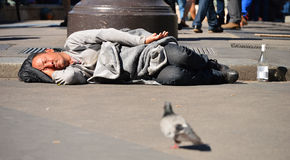 Homeless man sleeping on the street in Paris Stock Photos