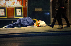 Homeless man sleeping on the street Royalty Free Stock Photo