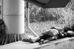Homeless Man Sleeping Under the Troll Way Black and White Color stock photos