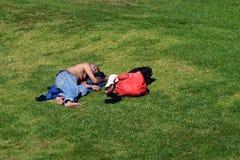Homeless man. A homeless man sleeping in an urban park Royalty Free Stock Photography