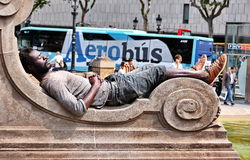 Homeless man sleeps in Barcelona Royalty Free Stock Photography