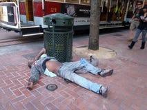 Homeless man sleeps on ground resting royalty free stock photo