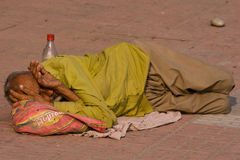 Homeless man sleeps on the sidewalk near the River Ganges in Haridwar, India. Royalty Free Stock Image
