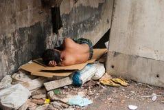 Homeless man sleeps on the street , Bangkok thailand. Royalty Free Stock Photography