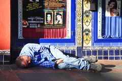 Homeless man sleeps on the street Royalty Free Stock Images