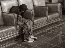 Homeless Man Sleeps at the Train Station Stock Images