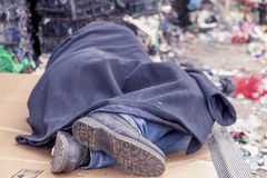 Homeless man sleeps in the waste Royalty Free Stock Photos