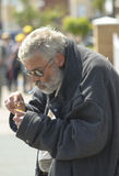 A homeless man smoking. Royalty Free Stock Images